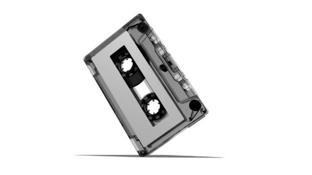 rotazione cassetta nastro con alfa hd 1080 p loop - cassetta video stock e b–roll