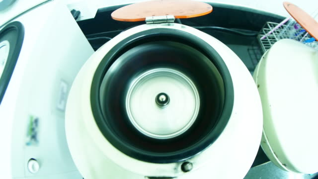 rotating centrifuge with sample containers - centrifuge stock videos & royalty-free footage