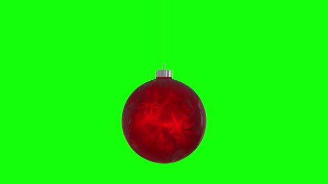 vidéos et rushes de boule de noel tournante, représente joyeux noel. boucle sans couture, fond alpha de greenbox isolé 4k stock vidéo - ball