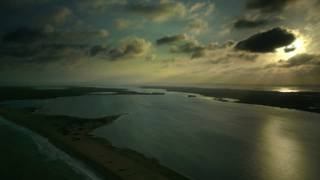 rotating drone shot of dramatic sunset over the rural countryside and lagoons in kalpitiya, sri lanka - dappled light stock videos and b-roll footage