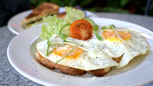 rotating fried egg with toast for breakfast - brunch stock videos & royalty-free footage