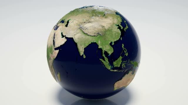 vídeos de stock e filmes b-roll de loopable rotativa globo - oceano pacífico