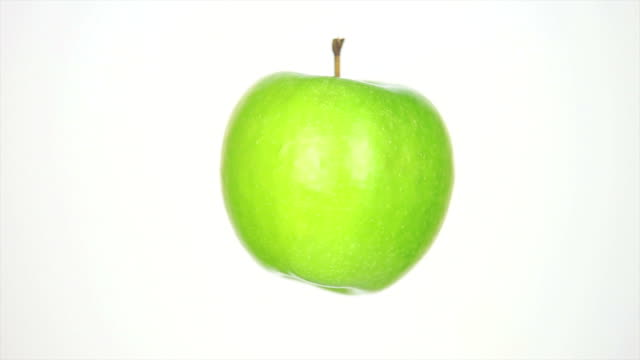 rotating green apple isolated on white - drehen stock videos & royalty-free footage