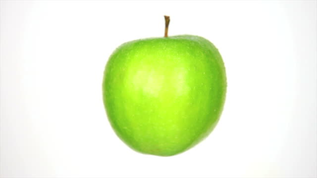 rotating green apple isolated on white - textfreiraum stock videos & royalty-free footage