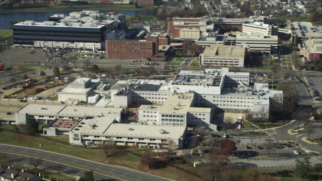 rotating high over the department of veterans affairs medical center in washington dc. shot in november 2011. - artbeats stock videos & royalty-free footage