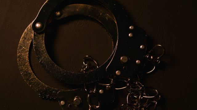 ms rotating metal handcuffs - justice concept stock videos & royalty-free footage
