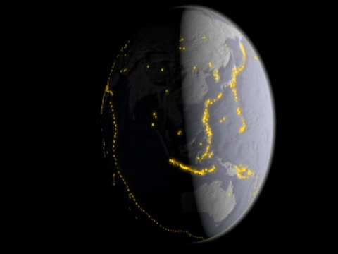 Rotating model of planet earth highlighting major areas of volcanic activity.