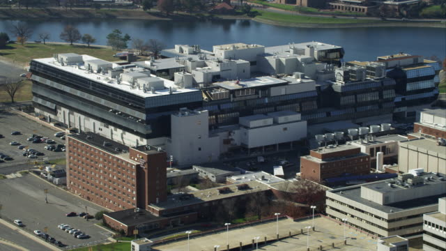 rotating over the children's hospital in washington dc, mcmillan reservoir in background. shot in november 2011. - children's hospital stock videos & royalty-free footage