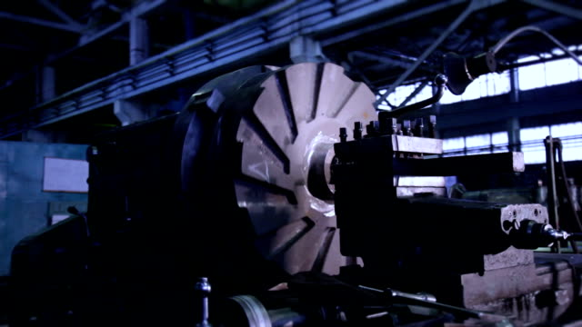Rotating part of Industrial lathe - background