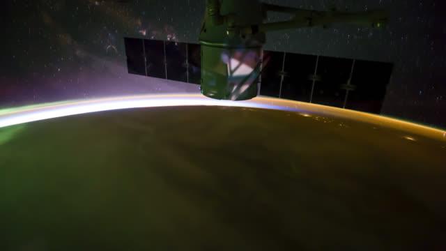 rotating planet earth with aurora and star galaxy. - 人工衛星点の映像素材/bロール