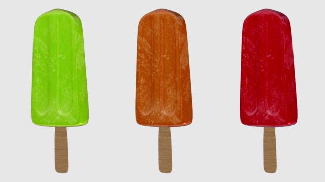 rotating popsicles with luma matte - luma matte stock videos & royalty-free footage