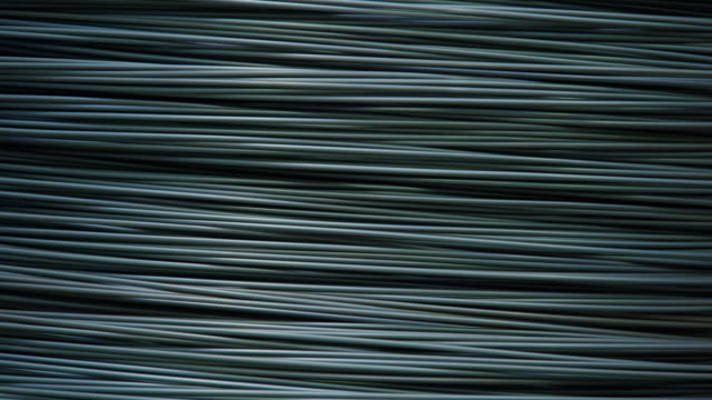 vídeos de stock, filmes e b-roll de rotating steel wire being thinned - indústria metalúrgica
