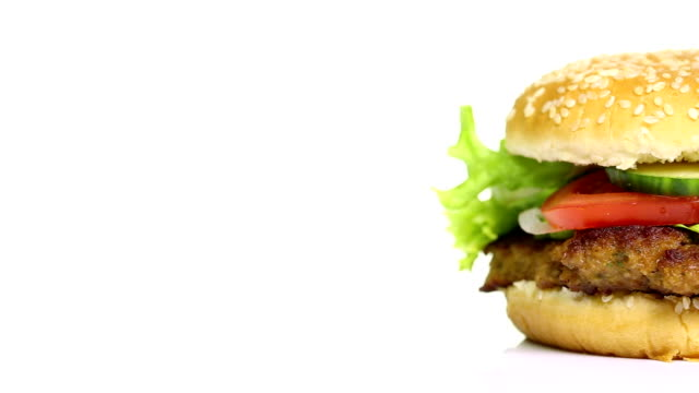rotating tasty hamburger on white background - hamburger stock videos and b-roll footage