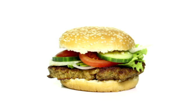 rotating tasty hamburger on white background - hamburger stock videos & royalty-free footage
