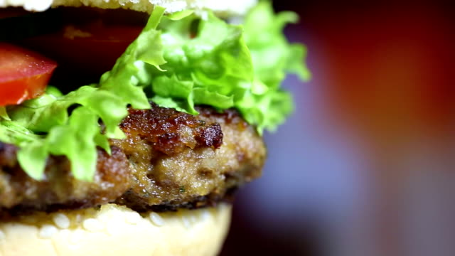 rotating tasty hamburger - hamburger stock videos and b-roll footage