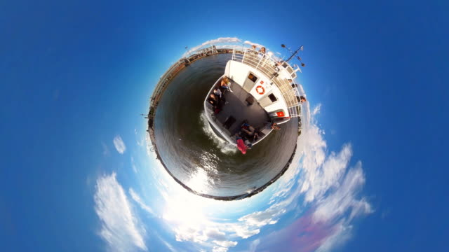 rotating tiny planet ferry in helsinki  - 360° time lapse - panoramic stock videos & royalty-free footage