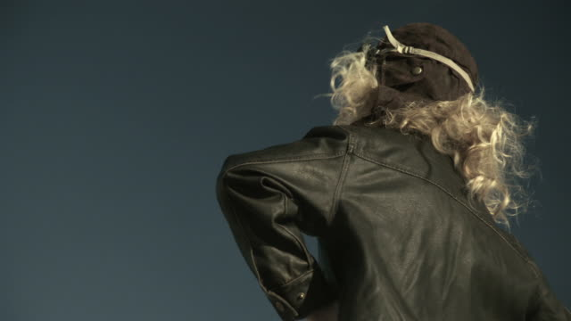 Rotating view of girl in pilot costume