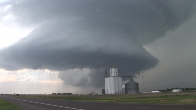A rotating wall cloud during a severe thunderstorm  is seen near