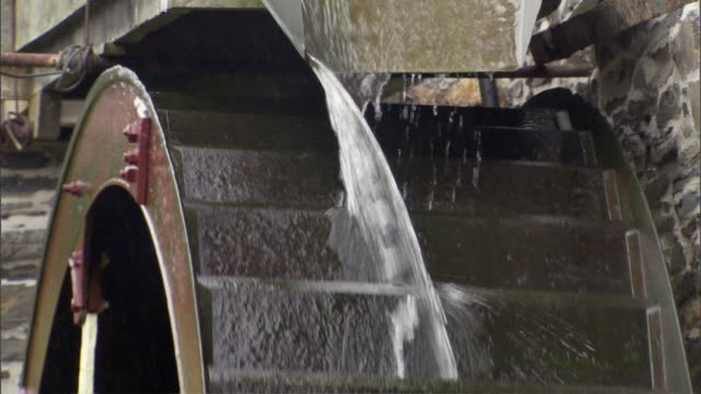 ms rotating water wheel / uk - watermill stock videos and b-roll footage