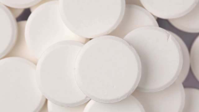 rotating white round pills - paracetamol stock videos and b-roll footage