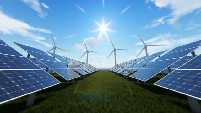rotating windmills and energy panels - solar panels stock videos & royalty-free footage