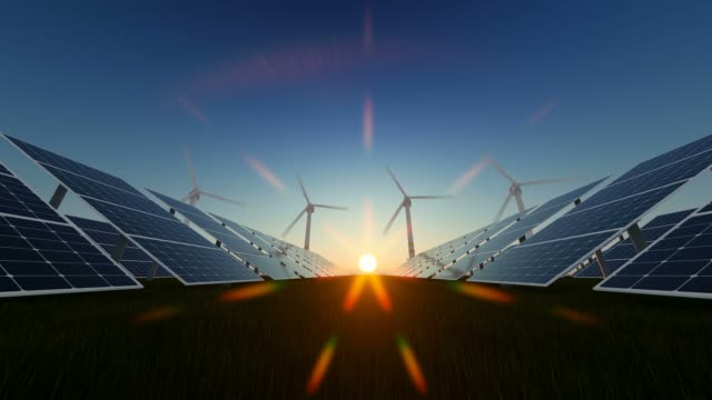 rotating windmills and solar panels at sunset - solar panel stock videos & royalty-free footage