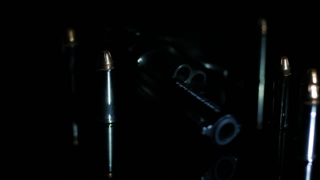 rotation of bullets and revolver gun - medium group of objects stock videos & royalty-free footage