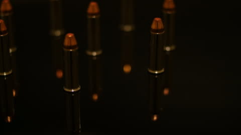 rotation of bullets and their reflection - medium group of objects stock videos & royalty-free footage