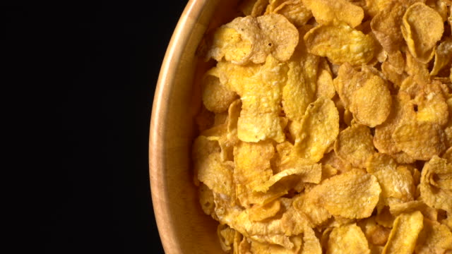 rotation of cereal flakes bowl and black background - plate stock videos & royalty-free footage
