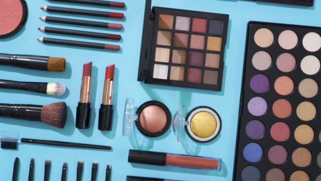 rotation of cosmetic and make up brush collection on blue background - group of objects stock videos & royalty-free footage