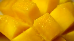 Rotation of rip mango slice cubes cut