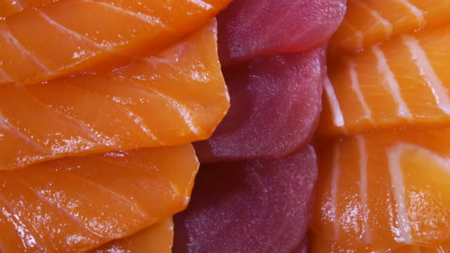 rotation of salmon and tuna sashimi close up shot - cutting stock videos & royalty-free footage
