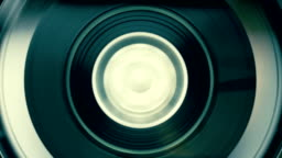 Rotation reel with tape on the video, audio tape recorder / player. Macro