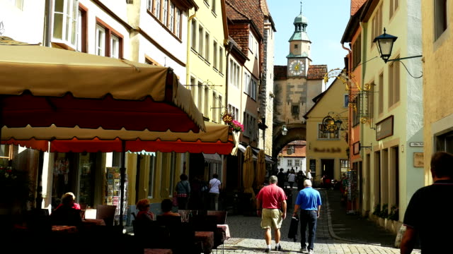 rothenburg hafergasse and roederbogen (4k/uhd to hd) - pavement cafe stock videos & royalty-free footage