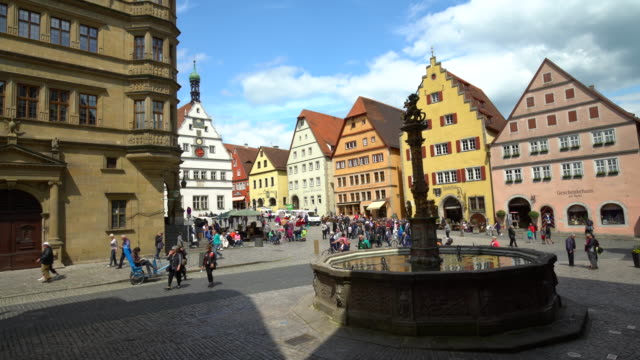 rothenburg ob der tauber, realtime marketplace with fountain and many people. - rothenburg stock videos and b-roll footage