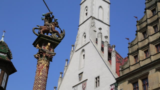 rothenburg ob der tauber, saint george's fountain and the gothic town hall in the background - rothenburg stock videos and b-roll footage