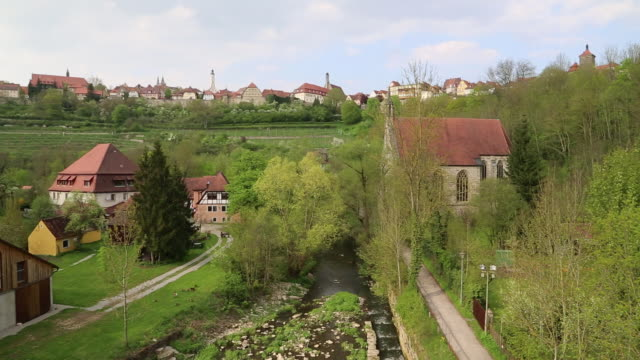 rothenburg ob der tauber, view of the tauber river and the city - rothenburg stock videos and b-roll footage
