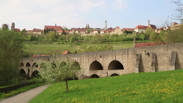 rothenburg ob der tauber, view of the valley and the city, and the double bridge in the foreground - rothenburg stock videos and b-roll footage