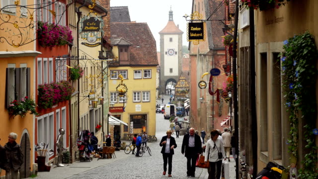 tu rothenburg obere schmiedgasse and siebers tower (4k/uhd to hd) - old town stock videos & royalty-free footage