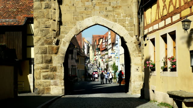 rothenburg old town viewed from siebers gate (4k/uhd to hd) - romantic road germany stock videos and b-roll footage