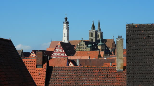 pan rothenburg skyline with city hall and st. james's church - romantic road germany stock videos and b-roll footage