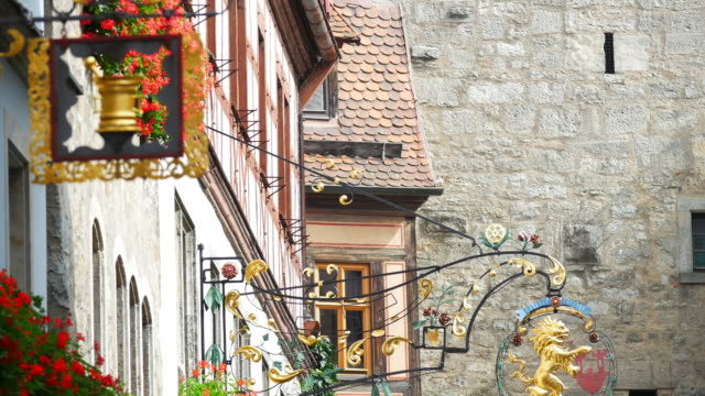 tu rothenburg timber framed houses with inn signs - romantic road germany stock videos and b-roll footage