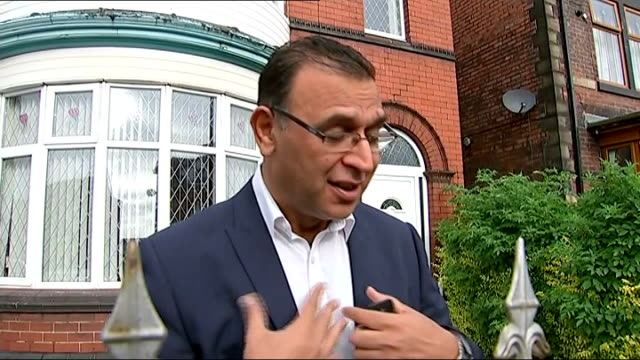 stockvideo's en b-roll-footage met jahangir akhtar doorstep england south yorkshire rotherham ext akhtar out of front door along towards news crew / jahangir akhtar interview on the... - kindermishandeling