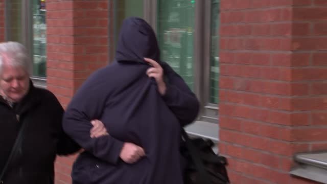 first convictions day shelley davies arriving at court with hood over face karen macgregor smiling as arrives at court - rotherham stock videos & royalty-free footage