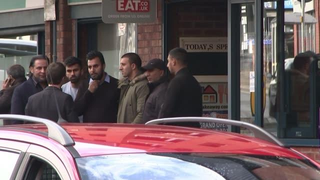 vidéos et rushes de trial begins group of asian men standing outside shop sign over court gv exterior of court building - procès