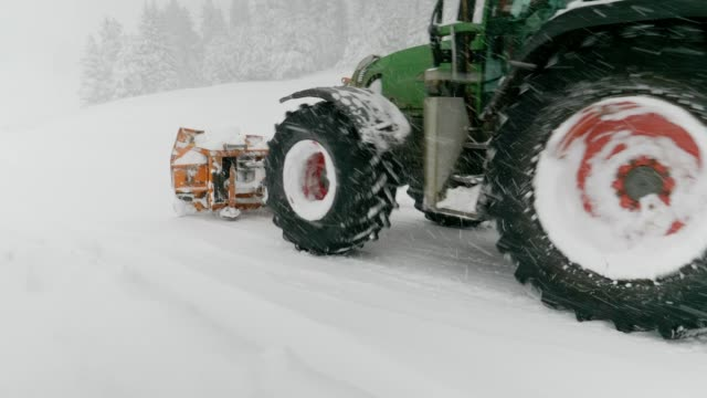 rotor snow-plough working over a winter mountain road. - absence stock videos & royalty-free footage