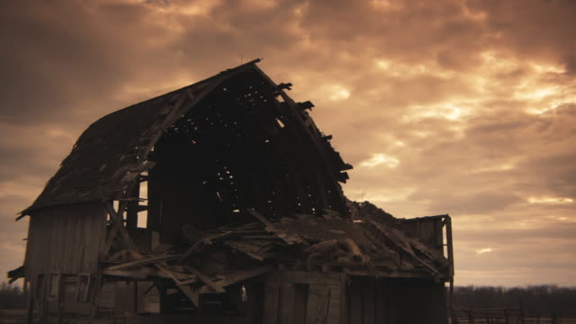 ms rotting barn with clouds at sunset in background, iowa, usa - barn stock videos and b-roll footage