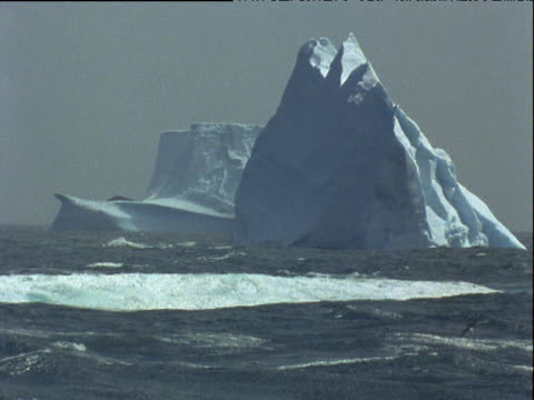 rough antarctic sea, big waves smash against icebergs, seabirds fly. - antarctica iceberg stock videos & royalty-free footage