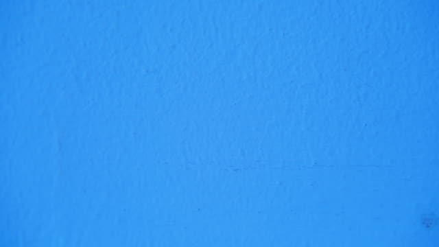 rough blue wall background - solid stock videos & royalty-free footage