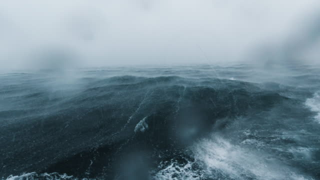 rough boat journey across ocean seascape during extreme weather monsoon storm - boat point of view stock videos & royalty-free footage
